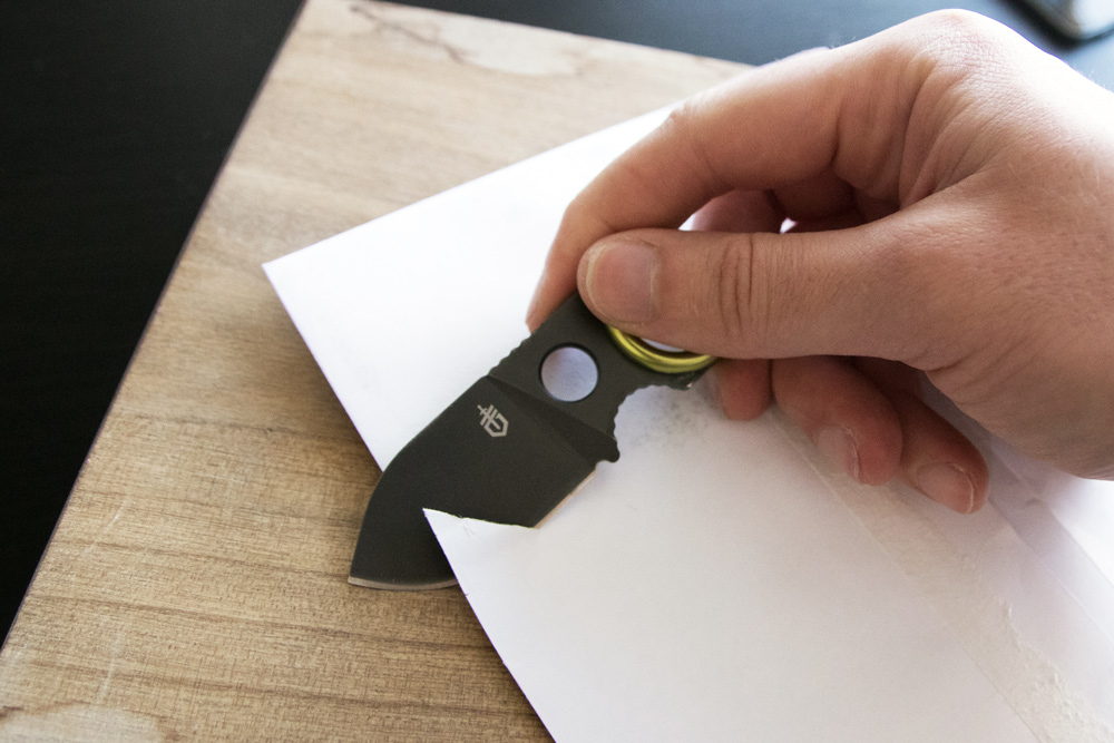 gerber gdc knife cutting through paper