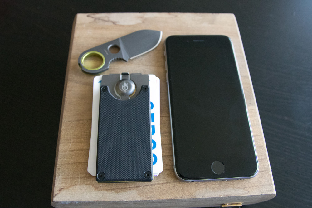 gerber gdc knife unsheathed next to iphone for scale